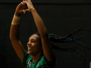 STACEY FRANCIS of the West Coast Fever shows the love as she runs out onto the court before the Super Netball match between the Fever and the Swifts at HBF Stadium in Perth, Australia.
