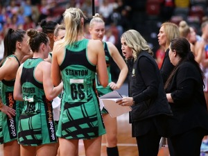 Fever coach STACEY MARINKOVICH talks to players during a time out during the Super Netball match between the Swifts and the Fever at Sydney Olympic Park Sports Centre in Sydney, Australia.