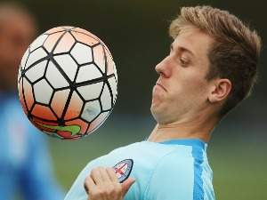 STEFAN MAUK headers the ball during a Melbourne City FC training session at City Football Academy in Melbourne, Australia.