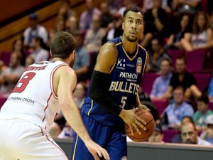 STEPHEN HOLT of the Bullets looks to pass during the NBL match between the Brisbane Bullets and the Illawarra Hawks at Brisbane Convention & Exhibition Centre in Brisbane, Australia.