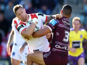 TARIQ SIMS of the Dragons is tackled by DYLAN WALKER of the Eagles during the NRL match between the St George Illawarra Dragons and the Manly Sea Eagles at WIN Stadium in Wollongong, Australia.