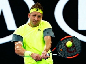 TENNYS SANDGREN of the United States plays a backhand against Dominic Thiem of Austria of the 2018 Australian Open at Melbourne Park in Australia.