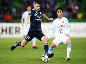TERRY ANTONIS of the Victory kicks the ball clear from RYOTA OSHIMA of Kawasaki Frontale during the AFC Asian Champions League match between the Melbourne Victory and Kawasaki Frontale at AAMI Park in Melbourne, Australia.