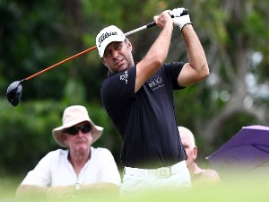TERRY PILKADARIS of Australia watches his tee shot on the 9th hole during the King's Cup at Phoenix Gold Golf and Country Club in Pattaya, Thailand.