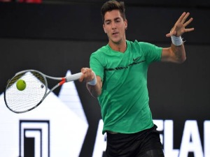 THANASI KOKKINAKIS of Australia competes in his match against Gael Monfils of France during the World Tennis Challenge at Memorial Drive in Adelaide, Australia.