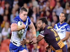 TIM BROWNE of the Bulldogs breaks through the defence during the NRL match between the Brisbane Broncos and the Canterbury Bulldogs at Suncorp Stadium in Brisbane, Australia.