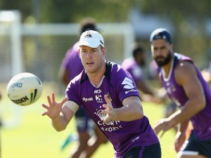 TIM GLASBY receives the ball during the Melbourne Storm NRL training session at Gosch's Paddock in Melbourne, Australia.