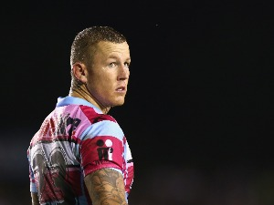 TODD CARNEY of the Sharks looks on during the NRL match between the Cronulla-Sutherland Sharks and the Wests Tigers at Remondis Stadium in Sydney, Australia.