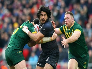 TOHU HARRIS of New Zealand is tackled by Shannon Boyd (R) of Australia during the Four Nations Final between New Zealand and Australia at Anfield in Liverpool, United Kingdom.