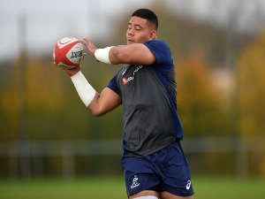 TOLU LATU of Australia receives a pass during a training session in Newport, Wales.