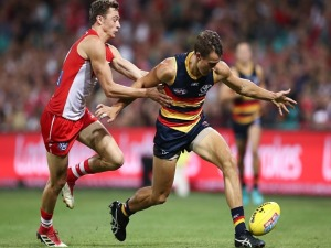 TOM DOEDEE of the Crows contests the ball WILL HAYWARD of the Swans during the AFL match between the Sydney Swans and the Adelaide Crows at SCG in Sydney, Australia.