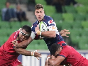 TOM ENGLISH of the Rebels runs with the ball during the Super Rugby match between the Melbourne Rebels and the Queensland Reds at AAMI Park in Melbourne, Australia.