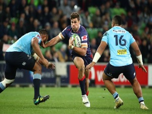 TOM ENGLISH of the Rebels runs with the ball during the Super Rugby match between the Rebels and the Waratahs at AAMI Park in Melbourne, Australia.