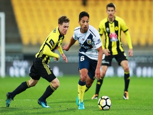 TOM HIARIEJ of the Mariners makes a break from Michael McGlinchey of the Phoenix during the A-League match between the Wellington Phoenix and the Central Coast Mariners at Westpac Stadium in Wellington, New Zealand.