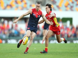 TOM MCDONALD of the Demons kicks during theAFL match between the Gold Coast Suns and the Melbourne Demons at The Gabba in Brisbane, Australia.