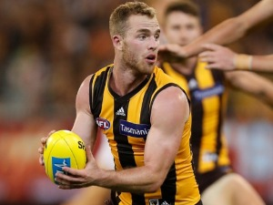 TOM MITCHELL of the Hawks in action during the 2018 AFL match between the Hawthorn Hawks and the Collingwood Magpies at the MCG in Melbourne, Australia.