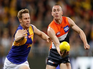 TOM SCULLY of the Giants and SAM MITCHELL of the Eagles in action during the 2017 AFL First Semi Final match between the GWS Giants and the West Coast Eagles at Spotless Stadium in Sydney, Australia.