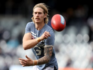 TOM STEWART of the Cats warms up for the AFL match between the Geelong Cats and the Fremantle Dockers at Simonds Stadium in Geelong, Australia.