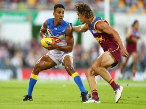 TOUK MILLER of the Suns runs the ball during the AFL match between the Brisbane Lions and the Gold Coast Suns at The Gabba on April 22, 2018 in Brisbane, Australia.