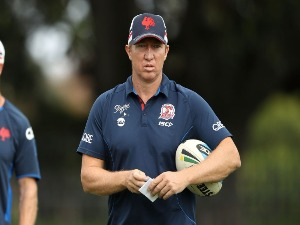 Roosters coach TRENT ROBINSON watches on during the Sydney Roosters NRL training session at Kippax Lake in Sydney, Australia.