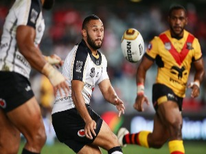 TYRONE PHILLIPS of Fiji passes during the International Rugby League Test match between Fiji and Papua New Guinea at Pirtek Stadium in Sydney, Australia.