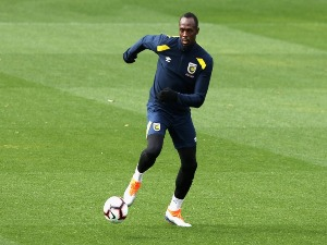 USAIN BOLT trains during a Central Coast Mariners training session at Central Coast Stadium in Gosford, Australia.