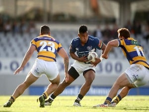 VINCE ASO of Auckland is tackled during the Mitre 10 Cup match between Auckland and Bay of Plenty in Auckland, New Zealand.