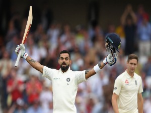 India batsman VIRAT KOHLI celebrates reaching his century during the 3rd Test Match between England and India in Nottingham, England.