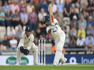 India batsman VIRAT KOHLI picks up some runs watched by Jos Buttler during the 4th Specsavers Test match between England and India in Southampton, England.