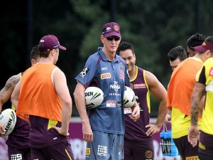 Coach WAYNE BENNETT talks to his players during the Brisbane Broncos NRL training session in Brisbane, Australia.