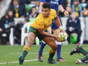 WILL GENIA of the Wallabies passes the ball during an International Test match at AAMI Park in Melbourne, Australia.