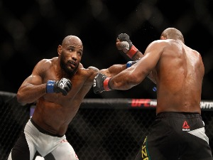 YOEL ROMERO(L) punches Ronaldo Souza in a middleweight fight in Las Vegas, Nevada.