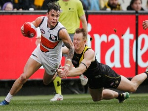 JACK RIEWOLDT of the Tigers tackles ZAC WILLIAMS of the Giants during the AFL match between the Richmond Tigers and the Greater Western Sydney Giants at MCG in Melbourne, Australia.