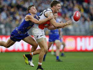 AIDAN CORR of the Giants handpasses the ball during the AFL match between the West Coast Eagles and the Greater Western Sydney Giants at Optus Stadium in Perth, Australia.