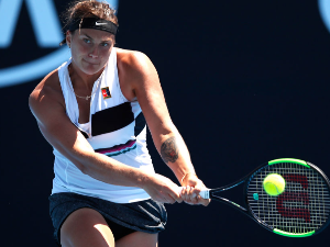 ARYNA SABALENKA of Belarus plays a backhand in her first round match against Anna Kalinskaya of Russia during day one of the 2019 Australian Open at Melbourne Park in Melbourne, Australia.