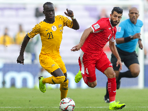 AWER MABIL of Australia competes for the ball with Baha' Abdel-Rahman of Jordan during the AFC Asian Cup Group B match between Australia and Jordan at Hazza Bin Zayed Stadium in Al Ain, United Arab Emirates.