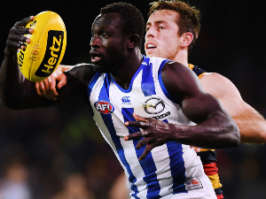MAJAK DAW of the Kangaroos competes with Richard Douglas of the Adelaide Crows during the AFL match between the Adelaide Crows and North Melbourne Kangaroos at Adelaide Oval in Adelaide, Australia.
