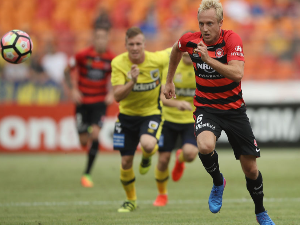MITCH NICHOLS of the Wanderers runs for the ball forward during the A-League match between the Western Sydney Wanderers and the Central Coast mariners at Spotless Stadium Sydney, Australia.