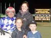 Chris Alford with wife Alison, and children Katie and Sam, after winning aboard Diamond Grace, his 6000th winner in the sulky, at Tabcorp Park Melton.