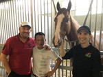 Danny Beasley (right) and another ex-jockey Soo Khoon Beng (middle) pose with their boss Daniel Meagher and his last winner Natural Impluse