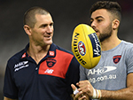 Ben Mathews the assistant coach speaks to Christian Salem in their round 6 match with Essendon last April