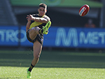 Dion Prestia of the AFL Tigers kicks the ball during their round 13 match against Sydney Swans at the MCG
