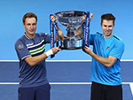 Australian John Peers  and partner Henri Kontinen lift the trophy after their doubles' win at the ATP Word Tour Finals in London. November 19, 2017
