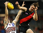 Joe Daniher of the Bombers spoils the ball over Giants' Phil Davis in a round 11 AFL clash