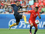 Mark Milligan of Australia Attempts to stop Alexis Sanchez of Chile from scoring at their Confederations Cup group B match in Russia.