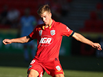 Riley McGree of Adelaide United kicks the ball during the round 23 A-League match against Brisbane Roar March 19, 2017