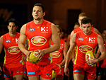 Steven May of the Suns leads his teammates on to the ground during their round 23 AFL match against Port Adelaide Power August 26, 2017