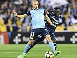 Thomas Deng of the Victory compete for the ball against a Sydney FC player in their A- League match in Melbourne Australia. October 7, 2017