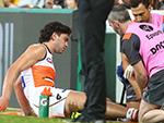 Tim Taranto of GWS injured during a round 14 game with Brisbane Lions