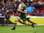 BILLY SLATER of Australia breaks away to score a try during the 2017 Rugby League World Cup Semi Final match at Suncorp Stadium in Brisbane, Australia